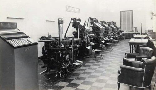 1940s photograph of an exhibition of blue streak linotype machines at the Mid-West Agency of the Mergenthaler Linotype Company, Chicago, Illinois