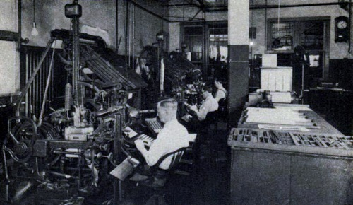 Linotypes and operators at the Gospel Trumpet Company, Anderson, Indiana