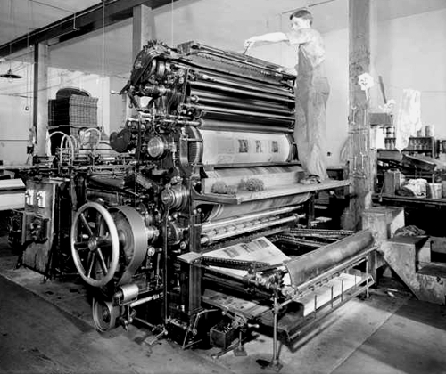 Two men working at a printing press at Smith-Brooks Printing Company in Denver, Colorado 1914