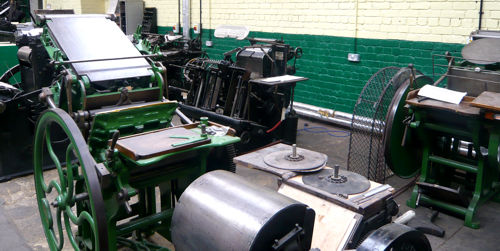 A couple more presses with a Heidelberg windmill in the background