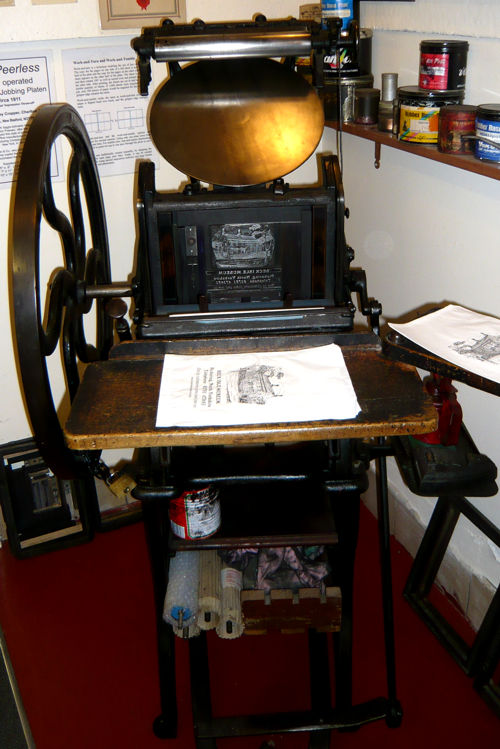 A Peerless hand-fed platen press